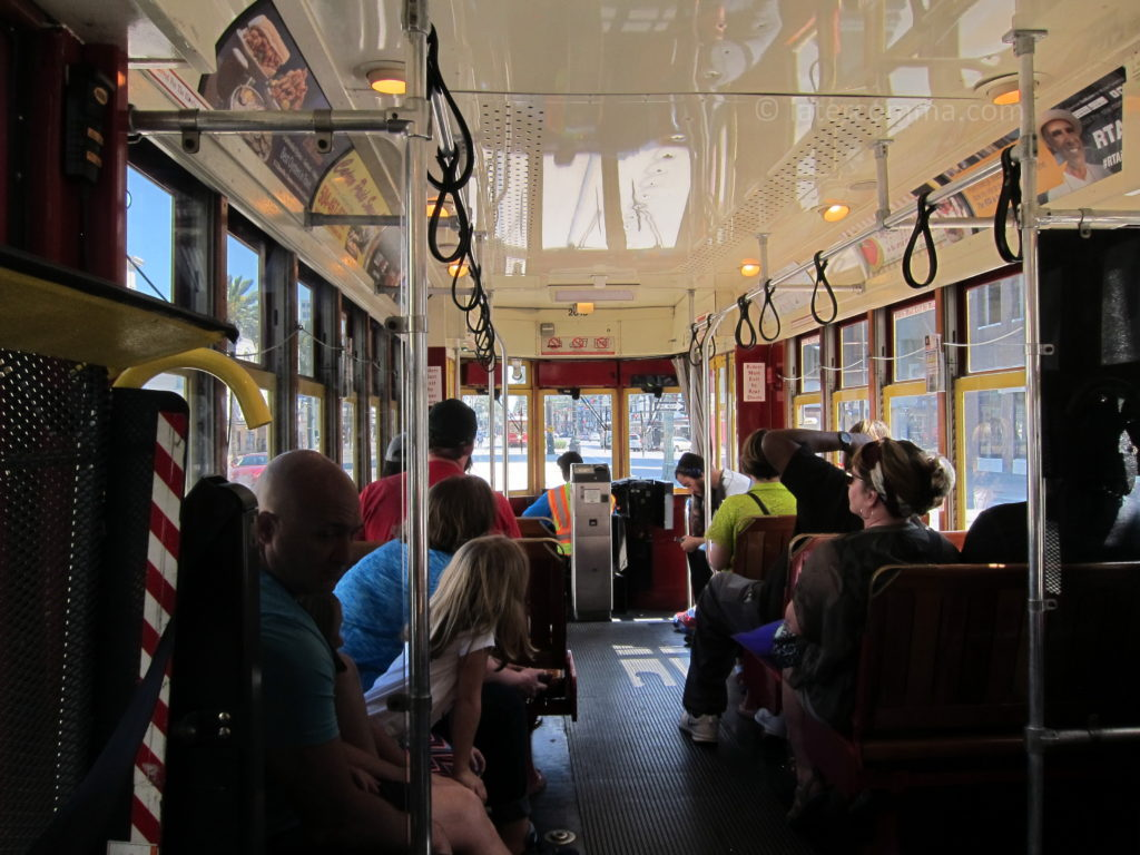 Riding the streetcar along Canal Street.